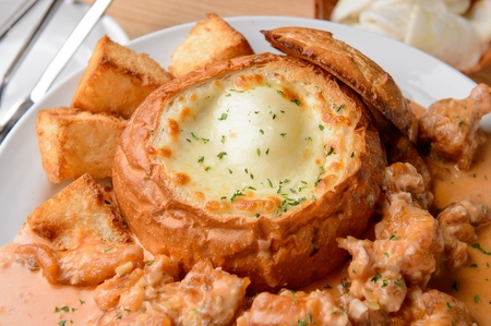 Bread filled with cheese served with chicken