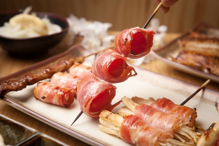 tomato bacon skewer, tomato mushroom skewer on  plate Stock Photo