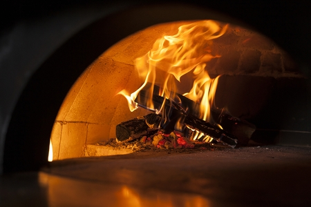 flaming pizza oven with fire woods