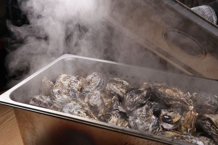 steamed oysters in steel container