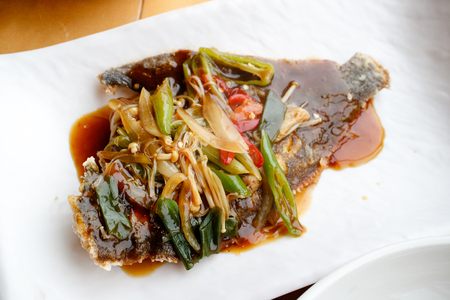 Flounder tangsuyuk, Korean-Chinese cuisine sweet and sour fish on white plate Standard-Bild