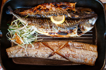 Grilled cutlass fish and mackerel on fry pan