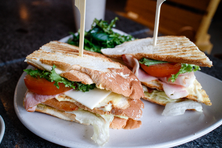 A sandwich with a toothpick on a white plate Reklamní fotografie