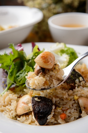 Seafood risotto on a white plate, on a spoon, close-up 版權商用圖片