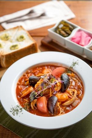 Pescatore tomato pasta on a wooden table