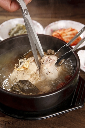 Chicken soup with ginseng and Chinese medicine, boiling in a pot