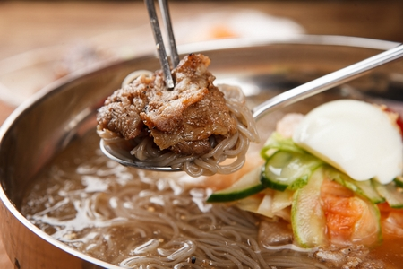famous Korean cuisine, Mul Naengmyeon, buckwheat noodles served in chilled soup made of dongchimi (radish kimchi) and beef broth Stock Photo