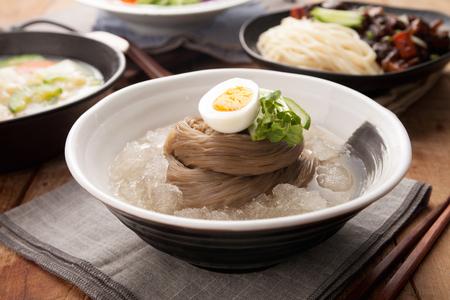 famous Korean cuisine, Mul Naengmyeon, buckwheat noodles served in chilled soup made of dongchimi (radish kimchi) and beef broth Stok Fotoğraf