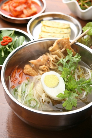Japanese cuisine, udon, with fish cakes, boiled eggs, on silver bowl