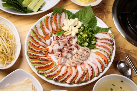 Mun-eo chohwe, boiled octopus sliced thinly, on plate