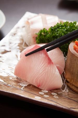 Chopsticks grabbing tuna sashimi 版權商用圖片