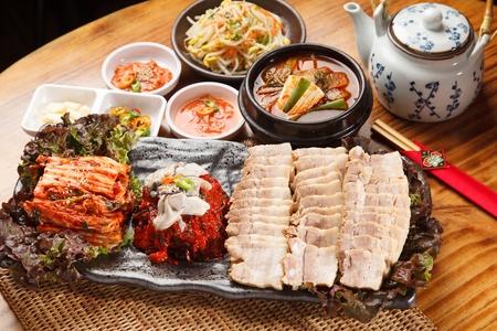 Bossam, a Korean cuisine, boiled pork, cabbage kimchi, radish kimchi
