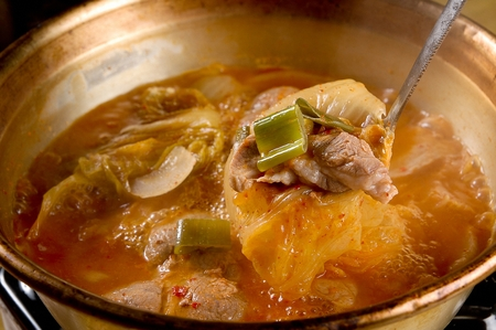 Kimchi jjigae, a Korean stew, boiled with pork and kimchi Stock Photo