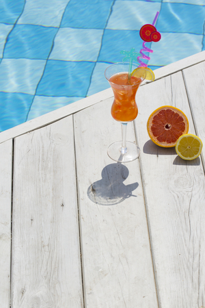 Summer holiday concept photo. vacation items and beach accessories in swimming pool or yellow background. 148