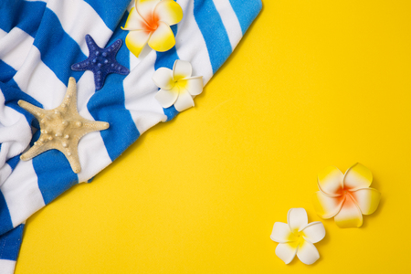 Summer holiday concept photo. vacation items and beach accessories in swimming pool or yellow background. 080