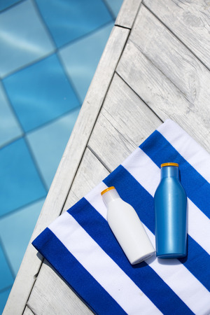 Summer holiday concept photo. vacation items and beach accessories in swimming pool or yellow background. 173