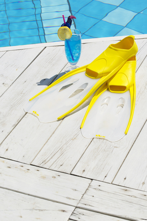 Summer holiday concept photo. vacation items and beach accessories in swimming pool or yellow background. 163