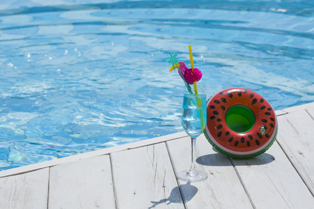 Summer holiday concept photo. vacation items and beach accessories in swimming pool or yellow background. 144