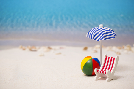 Summer holiday concept photo. vacation items and beach accessories in swimming pool or yellow background. 090