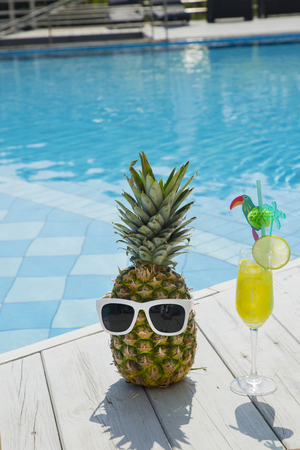 Summer holiday concept photo. vacation items and beach accessories in swimming pool or yellow background. 161