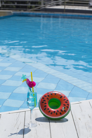 Summer holiday concept photo. vacation items and beach accessories in swimming pool or yellow background. Banque d'images