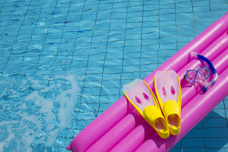Summer holiday concept photo. vacation items and beach accessories in swimming pool or yellow background. Stock Photo