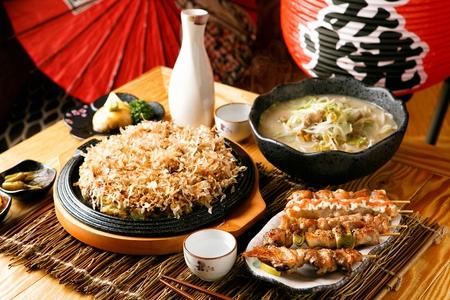 Okonomiyaki, nagasaki champon, assorted skewers with traditional japanese alcoholic beverage, the sake