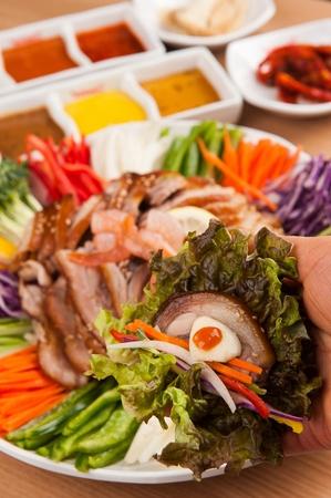 Naengchae-jokbal, thinly sliced pork served with various chilled vegetables