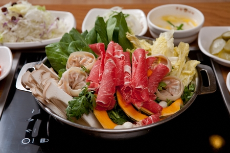 Shabu-shabu, thinly sliced beef and vegetables slightly parboiled in boiling broth