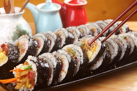 Kimbap on plate, on table