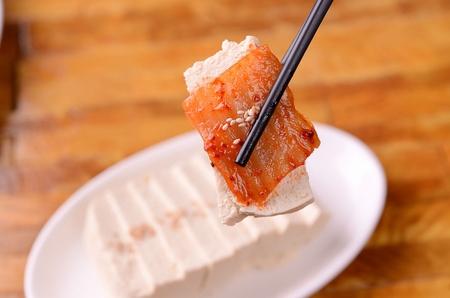 Tofu on plate, on table