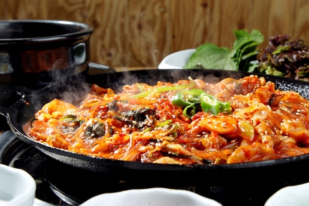 Gopchang bokkeum, grilled marinated tripes stir-fried with vegetables in spicy sauce