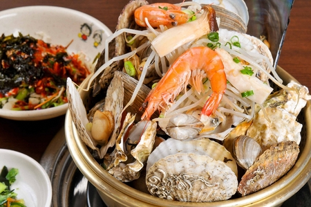 Steamed seafood, with shrimp, oysters, scallops and bean sprouts in nickel silver pot