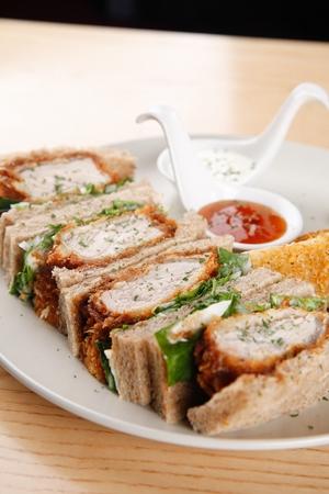 Katsu sandwich, with tonkatsu, on white plate