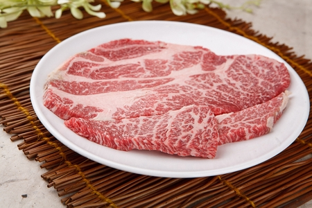 Frozen beef sirloin on round plate, close-up