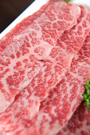 Beef chuck flat tail on rectangular plate, close-up