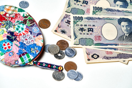 Closeup of Japanese Yen banknotes and Japanese Yen coin