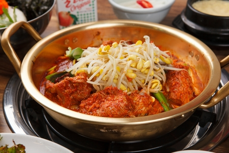Braised spicy back ribs with lots of bean sprouts, on nickel silver pot