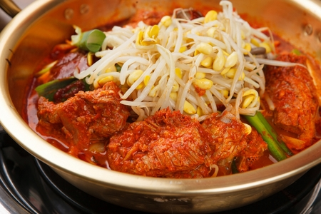 Braised spicy back ribs with lots of bean sprouts, in nickel silver pot