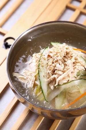Cold noodles with cucumber, young radish and chicken meat, in bowl