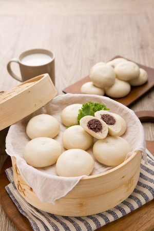 Steamed bun with adzuki beans filling, on plate