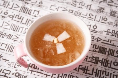 Hot pear tea in mug cup