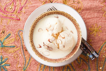 Vanilla ice cream and teaspoon in luxurious bowl