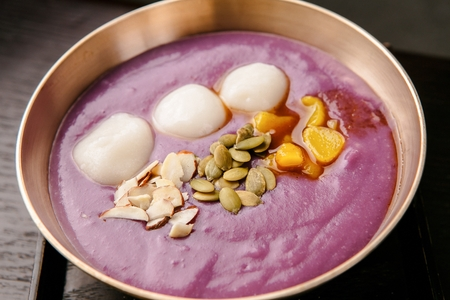 Sweet potato porridge with rice cakes and nuts in bowl