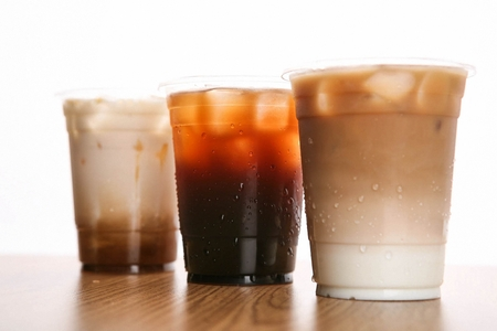 Iced americano and iced latte in plastic cup
