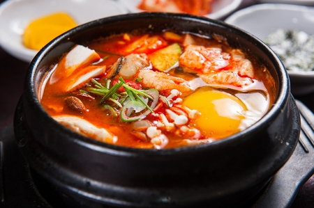 Soft tofu stew with egg, in pot