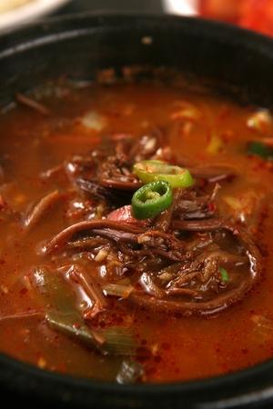 Hot spicy meat stew with bracken in pot