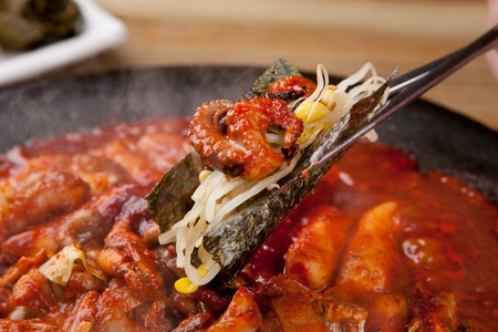 Stir-fried small octopus and dried seafood, on iron plate