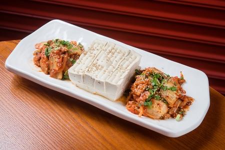 Tofu and Kimchi with sesame seeds on top served on plate 版權商用圖片