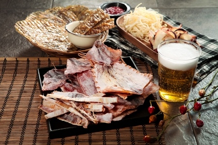 Grilled Squid on plate with beer Stock Photo